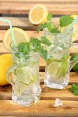 Drink with lime, lemon and ice — Stock Photo