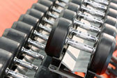 Dumbbells weights lined up in a fitness studio — Stock Photo