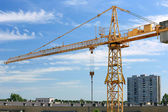 Industrial construction crane and buildings — Stock Photo