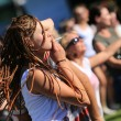 Постер, плакат: JAROCIN POLAND JULY 20: Young girl at a rock concert