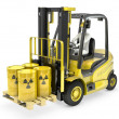 Fork lift truck with radioactive barrels — Stock Photo