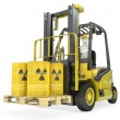 Fork lift truck with radioactive barrels — Stock Photo #14615987