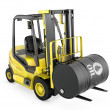 Yellow fork lift lifts oil barrel - Stock Photo