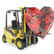 Stock Photo: Fork lift truck lifts heart cut ruby