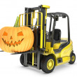 Yellow fork lift truck lifts halloween lantern — Stock Photo