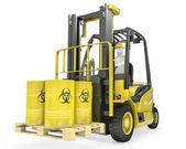 Fork lift truck with biohazard barrels — Stock Photo