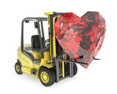 Fork lift truck lifts heart cut ruby — Stock Photo