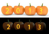 2013 text carved on pumpkin jack lantern — Stock Photo