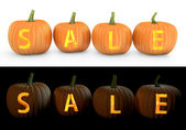 Sale text carved on pumpkin jack lantern — Stock Photo