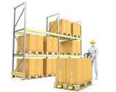 Worker moves boxes with pallet truck — Stock Photo