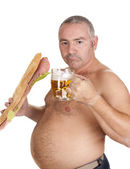 Man eating and drinking — Stock Photo
