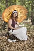 Reading umbrella — Stockfoto