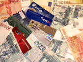 Ready cash and credit cards of different countries — Stock Photo