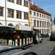 Tourist carriage on Prague roads — Stock Photo #28082997