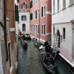 Gondolas on venetian canals — Stock Photo #28102491