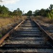 Stock Photo: Looking down Railroad tracks towards street