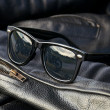 Stock Photo: Leather jacket detail with sunglasses