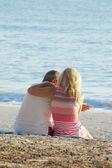 Mature couple on sand at beach — Stock Photo