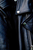 High contrast black leather biker jacket up close — Stock Photo