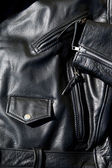 Vintage black leather motorcycle jacket — Stock Photo