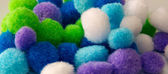 Colorful craft pompoms up close — Foto Stock