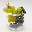 Stock Photo: Red and green grapes in glass vase
