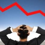 Depression businessman watching falling financial line — Stock Photo #10623132