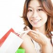 Happy asian woman with shopping bag — Stock Photo #11446747