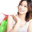 Happy young woman with shopping bag — Stock Photo #11686289