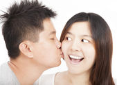 Asian young couple kissing — Stock Photo