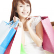 Happy smiling Shopping woman holding shopping bags isolated — Stock Photo #12257332