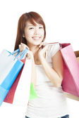 Happy smiling Shopping woman holding shopping bags isolated — Stock Photo