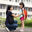 Stock Photo: Back to school.happy asimother with daughter in school