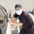 Man in mask trying to steal a car — Stock Photo #12724049
