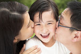 Happy asian family in kissing — Stock Photo
