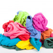 A pile of colorful clothes - Stock Photo