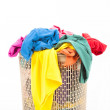 Colorful clothes in a laundry basket — Stock Photo