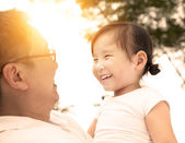 Happy little girl with father — Stock Photo