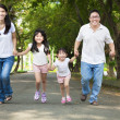 Happy asian family walking on the road — Stock Photo
