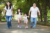 Happy asian family walking on the road — Stock Photo