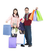 Happy asian family with shopping bag in winter clothing — Stock Photo