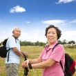 Asian Senior couple hiking in countryside — Stock Photo