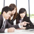 Happy asian business team working in office — Stock Photo #13814000