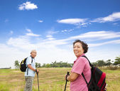 Happy asian senior couple hiking in the nature — Stock Photo