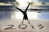 Happy new year 2013 on the beach — Zdjęcie stockowe