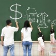 Royalty-Free Stock Photo: Family drawing money house clothes and video game symbol on the