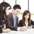 Asian business team working in office - Stock Photo