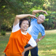 Happy asian senior fitness couple in the park — Stock Photo