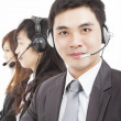 Smiling businessmwith call center agent — Stock Photo #14274571