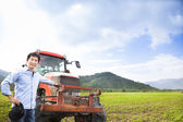 Happy asian farmer with Old tractor on the grass field — Stock Photo